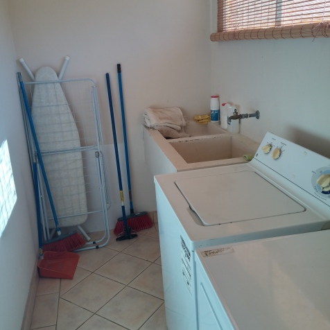 full size laundry room with ironing board